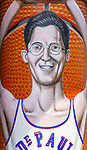 One of the three new murals installed under the Fullerton &quot;L&quot; Station in Lincoln Park, Saturday, July 28, 2018, features a caricature of DePaul basketball star George Mikan, a 1959 Naismith Memorial Basketball Hall of Fame inductee. Mikan's likeness was installed on a pillar directly under the CTA's Brown and Purple Line. Other murals installed in July 2018 include a montage of historical images highlighting the 50th anniversary of DePaul's Black Student Union and a mural celebrating the opening of the university's Loop Campus.<br /> <br /> Brother Mark Elder, C.M., an adjunct faculty member in DePaul&rsquo;s art, media and design program, conceived of the multi-year art project, titled &ldquo;The Story of &lsquo;The Little School Under the &lsquo;L&rsquo;&rsquo;. The project will eventually feature 25 murals permanently installed on the massive concrete pillars that support the &quot;L&quot; station nearest the university's Lincoln Park Campus. (DePaul University/Jamie Moncrief)