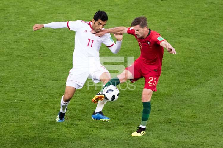 SARANSK, RUSSIA - June 25, 2018: Vahid Amiri of Iran and Adrien Silva of Portugal fight for a loose ball in their 2018 FIFA World Cup group stage match at Mordovia Arena.