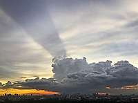 Spectacular Rainstorm over the Wak-Wak Golf Course and Manila skyline.