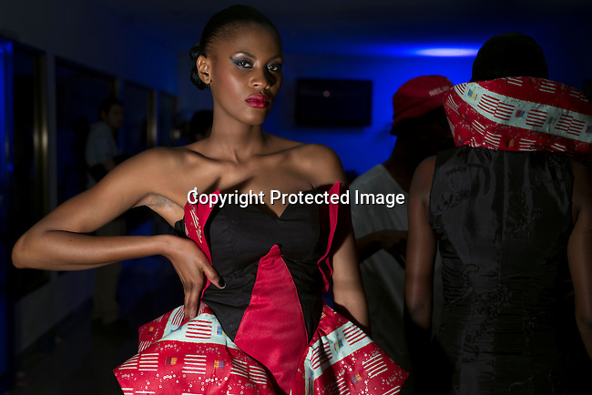KINSHASA, DRC - JULY 25: Fashion models walking for the designer Okapi de la mode wait backstage before a show at Kinshasa Fashion Week on July 25, 2015, at Shark club in Kinshasa, DRC. Local and invited foreign-based designers showed their collections during the second edition of Kinshasa Fashion week. Photo by Per-Anders Pettersson)