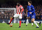 Mame Biram Diouf of Stoke City is challenged by Marcos Alonso of Chelsea during the premier league match at Stamford Bridge Stadium, London. Picture date 30th December 2017. Picture credit should read: Robin Parker/Sportimage