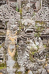 Ubud, Bali, Indonesia; stone carvings inside the Balinese Hindu temple, Pura Taman Saraswati