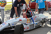 Jacques Villeneuve, uncle waiting in his Formula Tour 1600 car for the after race weight in at the GP3R in Trois-Rivieres, Quebec