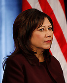 Chicago, IL - December 19, 2008 -- United States Representative Hilda Solis (Democrat of California), Secretary of Labor-designate looks on as United States President-elect Barack Obama announces her nomination at a press conference Friday afternoon, December 19, 2008 at the Drake Hotel in Chicago, Illinois..Credit: Anne Ryan - Pool via CNP