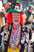 2 March 2014, Duesseldorf, Germany. Pictured: Person dressed as a clown. Costumed carnival-goers enjoy the sunshine as they celebrate with a street party in Duesseldorf, North Rhine-Westphalia, Germany.
