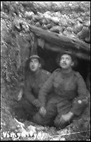 BNPS.co.uk (01202 558833)<br /> Pic: PoppylandPublishing/BNPS<br /> <br /> Two soldiers in the trenches.<br /> <br /> Left to gather dust in a darkened attic for decades, they are the diaries and secret photos documenting the hell and horrors of the battlefields of the First World War.<br /> <br /> It wasn't until Heather Brodie had a clear out that the unknown but remarkable archive kept by her late father, Sergeant Horace Reginald Stanley, came to light.<br /> <br /> His emotive diary and remarkable images taken with a camera he smuggled into the trenches paint a harrowing picture of life on the front line at Ypres and The Somme.<br /> <br /> He wrote of how he witnessed comrades next to killed by German shelling and described the hopelessness and terror one felt as the men waited for their turn to be hit.<br /> <br /> His writings were even more poignant as his elder brother Frederick was killed after his dugout suffered a direct hit near Arras.