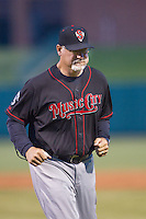Nashville Sounds pitching coach Don Schulze (37) walks back to the dugout after a meeting on the mound in a Pacific Coast League game against the Oklahoma City Dodgers at Chickasaw Bricktown Ballpark on April 15, 2015 in Oklahoma City, Oklahoma. Oklahoma City won 6-5. (William Purnell/Four Seam Images)