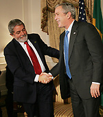 Brazil's president Luiz Lulu da Silva, left, and United States President George W. Bush exchange a handshake during their meeting at the Waldorf hotel on September 24,2007 in New York City. Bush will be meeting with several heads of state who are in the city for the United Nation's General Assembly meeting.  <br /> Credit: Monika Graff / Pool via CNP