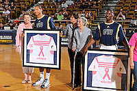 25 February 2012:  FIU players Cameron Bell (10, holding Kathryn Becker's jersey) and Deric Hill (1, holding Michelle Boyer's jersey)(also pictured, FIU Women's Basketball Coach Cindy Russo (center) with her mother, Bertha Russo) participate in a ceremony honoring cancer survivors prior to the game.  The FIU Golden Panthers defeated the University of South Alabama Jaguars, 81-74, at the U.S. Century Bank Arena in Miami, Florida.