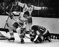 Philadelphia Flyers vs California Golden Seals Hockey,<br />Seals #21 Dennis Maruk and Jim Neilson. Flyer is #16 Bobby Clarke. (photo by Ron Riesterer)