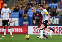 Bolton Wanderers' Joe Williams competing with Swansea City's Oliver McBurnie<br /> <br /> Photographer Andrew Kearns/CameraSport<br /> <br /> The EFL Sky Bet Championship - Bolton Wanderers v Swansea City - Saturday 10th November 2018 - University of Bolton Stadium - Bolton<br /> <br /> World Copyright © 2018 CameraSport. All rights reserved. 43 Linden Ave. Countesthorpe. Leicester. England. LE8 5PG - Tel: +44 (0) 116 277 4147 - admin@camerasport.com - www.camerasport.com
