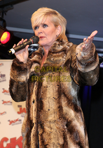 Bernie Nolan performs at Stevenage Christmas Lights switch on, Stevenage, Herts, England..November 17th 2011.stage concert live gig performance music in on half length brown fur jacket singing hand arm.CAP/JIL.©Jill Mayhew/Capital Pictures.