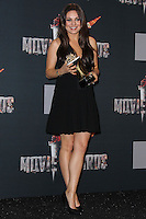 LOS ANGELES, CA, USA - APRIL 13: Mila Kunis in the press room at the 2014 MTV Movie Awards held at Nokia Theatre L.A. Live on April 13, 2014 in Los Angeles, California, United States. (Photo by Xavier Collin/Celebrity Monitor)