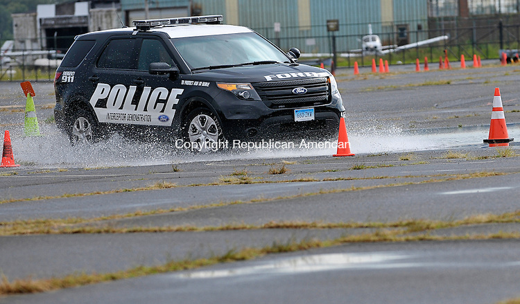 STATFORD, CT - 28 August 2012-082812EC01--    Cops in Fairfield and Ridgefield set up a driving academy for fellow officers who want to learn to drive the new Ford Interceptors.  The familiarization course deals with maneuvering through wet conditions, driving through narrow roads, and rapid braking.  Some departments are using the new Interceptors and phasing out the Crown Victorias.   Erin Covey Republican American.