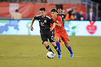 EAST RUTHERFORD, NJ - SEPTEMBER 7: Hirving Lozano #22 of Mexico battles for the ball with Alfredo Morales #15 of the United States during a game between Mexico and USMNT at MetLife Stadium on September 6, 2019 in East Rutherford, New Jersey.