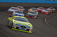 Apr 22, 2006; Phoenix, AZ, USA; Nascar Nextel Cup driver Greg Biffle of the (16) Subway/National Guard Ford Fusion leads the field during the Subway Fresh 500 at Phoenix International Raceway. Mandatory Credit: Mark J. Rebilas-US PRESSWIRE Copyright © 2006 Mark J. Rebilas..