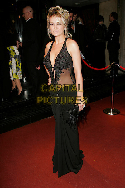 KIERSTON WAREING.The British Academy Television Awards 2008 after party held at the Grosvenor House Hotel,London, England..April 20th, 2008 .BAFTA BAFTA's full length black dress  sheer clutch bag.CAP/AH.©Adam Houghton/Capital Pictures.