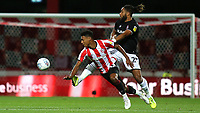 Brentford's Ollie Watkins takes the ball past Ashley Williams of Bristol City during Brentford vs Bristol City, Sky Bet EFL Championship Football at Griffin Park on 2nd October 2019