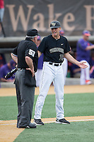 Wake Forest Demon Deacons head coach Tom Walter (16) argues a call with home plate umpire Michael Cerra during the game against the Clemson Tigers at David F. Couch Ballpark on March 12, 2016 in Winston-Salem, North Carolina.  The Tigers defeated the Demon Deacons 6-5.  (Brian Westerholt/Four Seam Images)