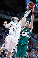 Real Madrid's Martynas Pocius (l) and Zalgiris Kaunas' Ksistof Lavrinovic during Euroleague 2012/2013 match.January 11,2013. (ALTERPHOTOS/Acero) NortePHOTO