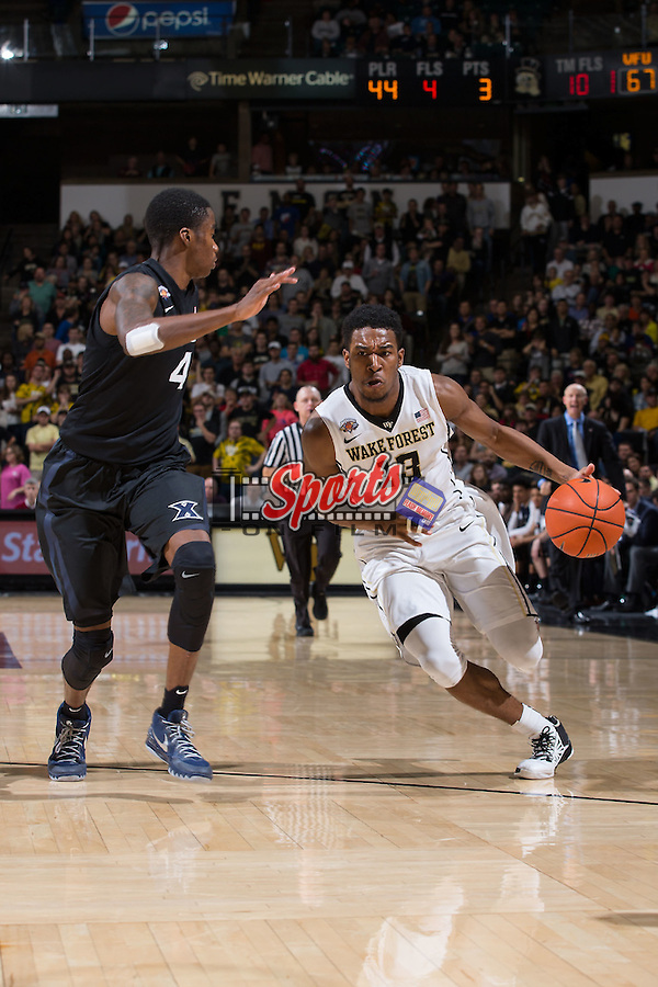 Bryant Crawford (13) of the Wake Forest Demon Deacons tries to drive past Edmond Sumner (4) of the Xavier Musketeers during second half action at the LJVM Coliseum on December 22, 2015 in Winston-Salem, North Carolina.  The Musketeers defeated the Demon Deacons 78-70.  (Brian Westerholt/Sports On Film)