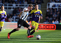 Pictured: Pablo Hernandez of Swansea (R) against Mathieu Debuchy (L) of Newcastle. Saturday 19 April 2014<br />