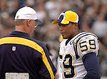San Diego Chargers linebacker Ronney Edwards (59) talks to coach Marty Schottenhiemer on Sunday, September 28, 2003, in Oakland, California. The Raiders defeated the Chargers 34-31 in overtime.