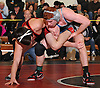 Lucas Pincus of Hewlett, right, controls the left leg of Tom Repalone of Connetquot at 138 pounds during the final round of the 2016 Ted Petersen Tournament at Island Trees High School on Saturday, Jan. 2, 2016. Pincus won by major decision 9-1.