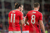 Gareth Bale of Wales celebrates scoring his side's fourth goal with Andy King during the FIFA World Cup Qualifier match between Wales and Moldova at Cardiff City Stadium, Cardiff, Wales on 5 September 2016. Photo by Mark  Hawkins.