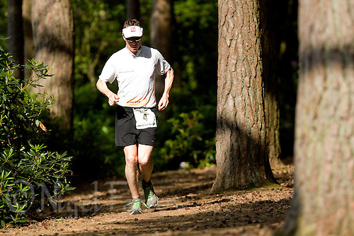 10 JUN 2011 - BRANSGORE, GBR - Gerry Duffy runs along the tracks of Avon Tyrell on his way to completing his 8th Enduroman event in eight days during the Deca Enduroman at the Enduroman Ultra Triathlon Championships (PHOTO (C) NIGEL FARROW)