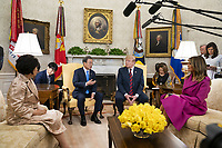 US President Donald J. Trump (C-R) welcomes Korean President Moon Jae-in (C-L) to the Oval Office of the White House while Mrs. Kim Jung-sook  (L) and US First Lady Melania Trump (R) look on in Washington, DC, USA, 11 April 2019. President Moon is expected to ask President Trump to reduce sanctions on North Korea in an attempt to jump start nuclear negotiations between North Korea and the US.<br /> CAP/MPI/RS<br /> ©RS/MPI/Capital Pictures