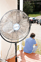 A fan brings in outside air as Vermont senator and Democratic presidential candidate Bernie Sanders speaks at a campaign event at the White Mountain Chalet event hall in Berlin, New Hampshire. The room was very hot.