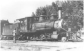 3/4 engineer's-side view of C-19 #344 at Montrose?  Engineer in cab and workman standing by engine.<br /> D&amp;RGW  Montrose ?, CO