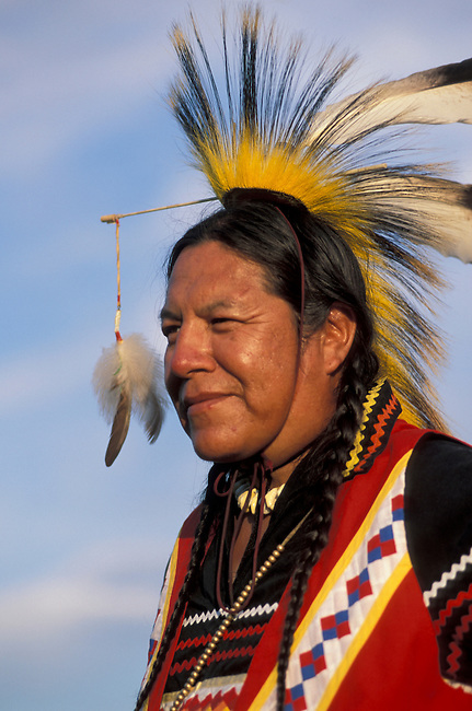 Close up of Blackfeet tribal member dressed in traditional mens pow wow regalia and roach headdress, Browning Montana