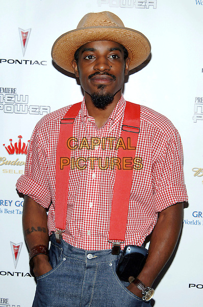 """ANDRE 3000.""""Premiere The New Power"""" held at the Roosevelt Hotel, Hollywood, CA , USA, 16 June 2005..half length hat red shirt braces.Ref: ADM.www.capitalpictures.com.sales@capitalpictures.com.©Jacqui Wong/AdMedia/Capital Pictures."""