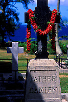 Father Damien's headstone draped with a lei, located outside of St. Philomena Church in the Kalawao district on the Kalaupapa peninsula
