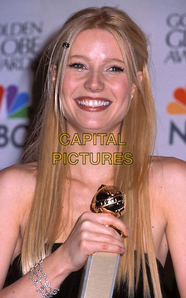 GWYNETH PALTROW.Golden Globe Awards 1999.Ref: 8179.portrait headshot, blonde hair, smiling, crying, award in hand, diamond bracelet.sales@capitalpictures.com.www.capitalpictures.com.©Capital Pictures