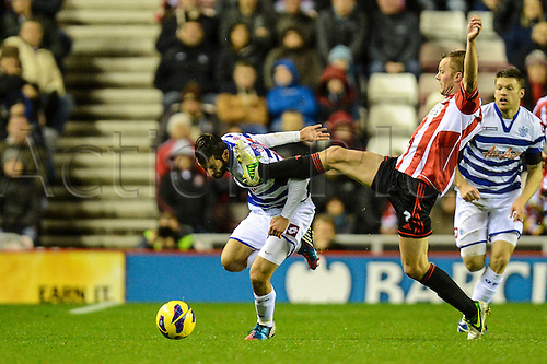 27.11.2012 Sunderland, England. QPR's Esteban Granero narrowly evades Sebastian Larsson's high foot during the Premier League game between Sunderland and Queens Park Rangers at the Stadium of Light.