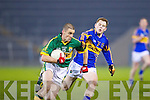 Kerry's Stephem O'Brien races past Tipperary's Donagh Leahy last Wednesday night in Semple Stadium in the Cadbury Munster U21 Football Champonship