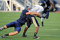 12 August 2011:  FIU's Justin Halley (32) tackles Clinton Taylor (31) during a scrimmage held as part of the FIU 2011 Panther Preview at University Park Stadium in Miami, Florida.