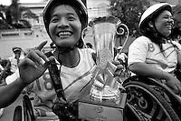 Sockchan faking a victory she didn't get. Kroeung Vannon, behind Sokchan, won this year. Phnom Penh, Cambodia - 2008