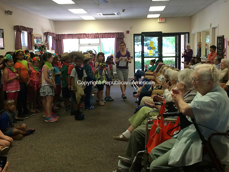 "TORRINGTON, CT - 10 June 2015- 061015CH2 -- Forbes School 2nd graders perform ""How Does Your Garden Grow?"" for residents of the Workman, a congregate living home for the elderly."
