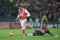 BOGOTA - COLOMBIA-11-05-2013: Wilder Medina (Izq.) jugador del Independiente Santa Fe disputa el balón con Ruben Bustos (Der.) de Boyaca Chico F.C., durante partido en el estadio Nemesio Camacho El Campin de la ciudad de Bogota, mayo 11 de 2013. Independiente Santa Fe y Boyaca Chico F.C., durante partido por la fecha 15 de la Liga Postobon I. (Foto: VizzorImage / Luis Ramirez / Staff). Wilder Medina (L) player of Independiente Santa Fe fights for the ball with Ruben Bustos (R) from Boyaca Chico F.C., during game in the Nemesio Camacho El Campin stadium in Bogota City, May 11, 2013. Independiente Santa Fe and Boyaca Chico F.C., during match for the round 15 of the Postobon League I. (Photo: VizzorImage / Luis Ramirez / Staff).