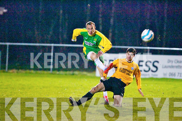 Garda Metro wing back,Kieran Kavanagh tries to block a shot on goal by Ginaturas Paketurus(Kerry district league)last Wednesday night Jan 15th at Mount Hawk park,Tralee.