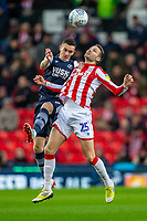 11th January 2020; Bet365 Stadium, Stoke, Staffordshire, England; English Championship Football, Stoke City versus Milwall FC; Nick Powell of Stoke City heads the ball - Strictly Editorial Use Only. No use with unauthorized audio, video, data, fixture lists, club/league logos or 'live' services. Online in-match use limited to 120 images, no video emulation. No use in betting, games or single club/league/player publications