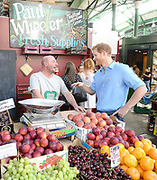 15 June 2017 - Prince Harry meets stall holder Paul Wheeler during a visit to Borough Market in London which has opened yesterday for the first time since the London Bridge terrorist attack. Photo Credit: ALPR/AdMedia