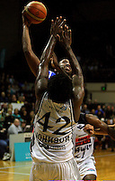 Kareem Johnson tries to stop Ernest Scott from scoring during the NBL Basketball match between the Wellington Saints and Bay Hawks, TSB Bank Arena, Wellington, New Zealand on Saturday, 10 May 2008. Photo: Dave Lintott / lintottphoto.co.nz