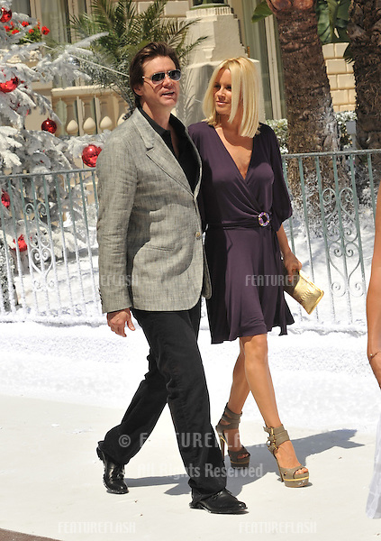 "Jim Carrey & girlfriend Jenny McCarthy  promoting his new movie Disney's ""A Christmas Carol"" at the 62nd Festival de Cannes..May 18, 2009  Cannes, France.Picture: Paul Smith / Featureflash"
