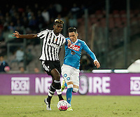 Calcio, Serie A: Napoli vs Juventus. Napoli, stadio San Paolo, 26 settembre 2015. <br /> Juventus&rsquo; Paul Pogba, left, and Jose' Maria Callejon fight for the ball during the Italian Serie A football match between Napoli and Juventus at Naple's San Paolo stadium, 26 September 2015.<br /> UPDATE IMAGES PRESS/Isabella Bonotto
