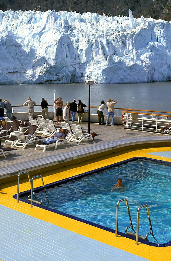 Holland-America Cruise Lines, Veendam.  Passengers at pool.  Margerie Glacier, Glacier Bay National Park, Alaska.